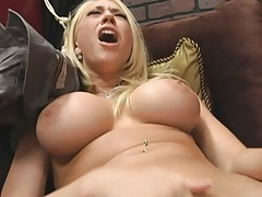 Blonde sexy business woman trying out new dildo