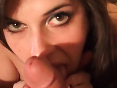 Chick on her knees blowing a cock close up