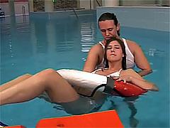 Brunette teenie gets face jizzed in a pool