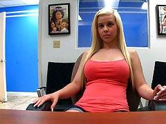 Blondie Whitney sitting behind the desk