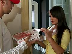 Savannah gets an order of pizza at the door