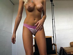 Sexy blondie on the chair spreading her legs