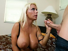 Big big tits Holly lays back and inserts shaft inside