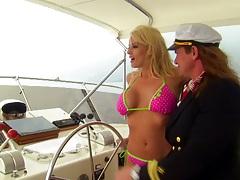 Bikini slut Stormy Daniels on a private boat sucks dick