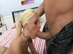 Blonde sucks an attempts to deep throat