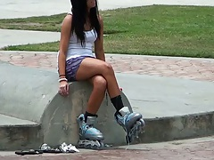 Sexy cutie brunette going rollerblading outdoors