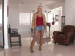 Blonde mifl Julia Castle sitting on the floor